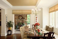 Build a Banquette - 79 Stylish Dining Room Ideas - Southernliving. Built-in banquette seating is a great option if you're short on space. It not only adds seating, but the space beneath the seat can also be used for storage. Using the same upholstery fabric helps tie together the mixed seating in this space.