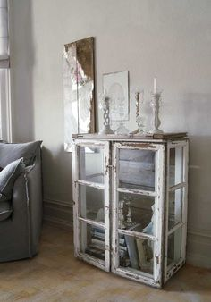 These old windows see a second life as a cabinet/ side table.
