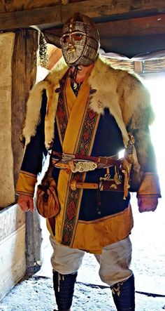 Anglo-Saxon men's wear; disregard the face front to the helmet. This shows correct positioning of the seax, the knife that gave its name to the Saxons, worn horizontally across the belly. / A Journey Through Medieval Life octavia.net