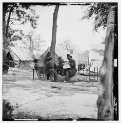 Mathew B. Brady was born May 18, 1822.  He was one of the most celebrated 19th century American photographers and is best known for his documentation of the American Civil War. He is credited with being the father of photojournalism. Photo: Gen. Ambrose E. Burnside (reading newspaper) with Mathew B. Brady (nearest tree) at Army of the Potomac headquarters