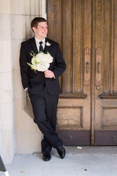 Groom with brides flowers- Wedding day pictures