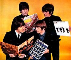 October 1965. Bill Francis photographic session of The Beatles with all their British releases.