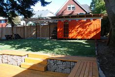 Edge of lower patio- solves the grade and drainage issue while providing built-in seating.