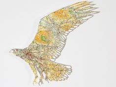 birds cut from antique maps by Claire Brewster