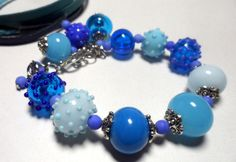 Handmade. LAMPWORK BRACELET. Glass Beads. Beads turquoise, blue, cornflower. by Glasskaramelka on Etsy https://www.etsy.com/listing/213266777/handmade-lampwork-bracelet-glass-beads