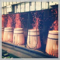 Fire charring the inside  will create different flavors in the wine that's stored in these Boutes French oak barrels .