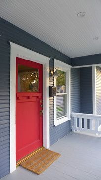 Red front door paired with blue siding & white trim. Lovely exterior color scheme.