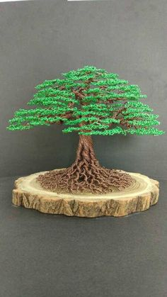 Handmade Green color tree wire Sculpture Birthday gift Christmas tree on natural wood Dimensions ( height * width) : 17 cm* 22cm Functions : furnishings