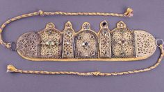 Inlaid Berber Jewelry Piece, Morocco .   A decorative Berber jewelry piece inlaid with jewels in a Moroccan museum.