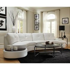 Simple and sleek. Our Talia Sectional by Coaster Furniture is a nice addition to any modern living room. Wrapped in a luxurious white bonded leather match with full foam seating, this sectional was crafted for comfort. featuring attached seat and back cushions, a sinuous spring base and a webbed back. Keep everything within an arm's reach with a built-in table top at the end of the sectional.
