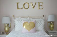 Pink and Gold Big Girl Bed in a Nursery - love the idea of including this so it's an easy transition!