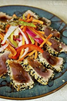 Seared Ahi tuna with pickled vegetables + soy glaze.