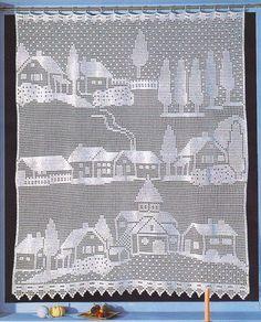 Uma cortina com casinhas.   manela