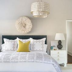 Fabulous bedroom features a tiered capiz chandelier, Smoked Capiz Two-Tier Pendant, over a white juju hat situated… Home, Home Bedroom, Capiz Chandelier, How To Dress A Bed, Bedroom Inspirations, Contemporary Bedroom, Blue Grey Rooms, Bedroom, Southern Homes