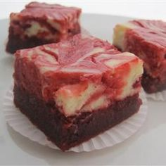 Red Velvet Cheesecake Swirl Brownies  Just made them and can't wait for them to cool!  From scratch brownies; no mixes here!