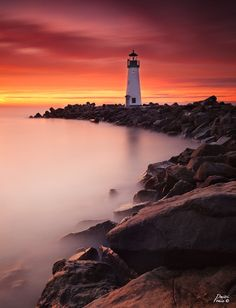 This is Walton lighthouse in Santa Cruz, California. This particular morning the sky lit up in fire and I used a 10 stop ND filter with GND filters to capture the amazing colors.  PS - WOW, thank you everyone for your comments and views. To answer one question in the comments (I have not figured out how to answer a person directly on this website - any tips :) ) - yes the 10 stop B+W filter does add warmth to the image, which is why I liked this one in particular. Another useful feature of…
