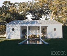 Steven Gambrel modeled the neo-Regency pool house at his house in Sag Harbor, New York, after a 1930s outbuilding at the former Hollywood home of film director George Cukor. Overscale trelliswork adorns the walls, and the roof is of lead-coated copper.   - ELLEDecor.com