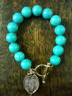 https://www.cityblis.com/4005/item/2246  Leaf drop bracelet (turquoise coloured jade beads) - $38 by Angie.L Design  Coloured jade beads in a turquoise colour with base metal toggle clasp and leaf pendant.