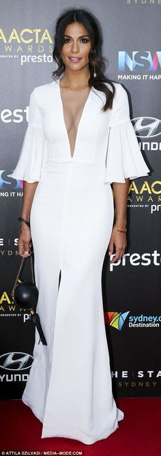 Taking the plunge: Pia Miller showed off her curves in a bright white dress with a dipped neckline and a rising split
