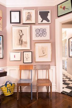 The blush color walls and fun mix of drawings and prints in this gallery art wall add a sophisticated touch to this eclectic decor.
