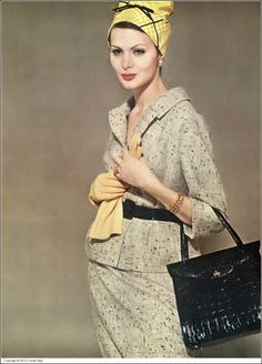 Isabella in a belted, beige and black flecked tweed suit by Harry Frechtel, plaid yellow silk hat by Sally Victor, chamois-colored gloves by Kislav, handbag by Nettie Rosenstein, jewelry by Van Cleef & Arpels, photo by Tom Palumbo, Vogue, January 1, 1960