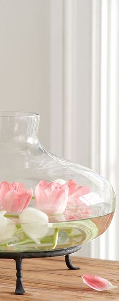 Delicate tulips floating in a glass vase | Spring Decorating Ideas