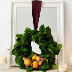 The lush green of this fall wreath has us swooning! Get more fall decor ideas here: http://www.bhg.com/decorating/seasonal/fall/fall-decorating-ideas/?socsrc=bhgpin081814fallwreath&page=6