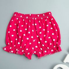These trendy polka dot designed bloomers are a fun way to cover your baby's bottom. The pure cotton material makes for a soft and comfortable fit.  The diaper covers are an excellent gift, photo prop and cute way to stay covered up and comfy in the house!  Here's an idea, get vintage photos by adding baby sun glasses, a head wrap and baby safe pearls. Create a fun background by using your heels and jewelry as props with a solid bold color back drop.