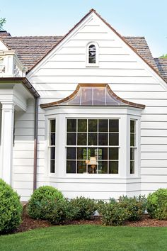 This original bay window is now topped in copper, which is a fitting complement to other copper accents found on the home's exterior. Soft, hand-split cedar shakes replaced the asphalt shingles, adding warmth and texture.