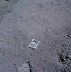 In 1972, as part of the Apollo 16 mission to the moon, astronaut Charles Duke embarked on a mission to the explore the moon's surface in a lunar roving vehicle. While there, he shot a picture of a photo of himself, his wife, and his two sons which was enclosed in plastic on the moon's surface, where it remains to this day.