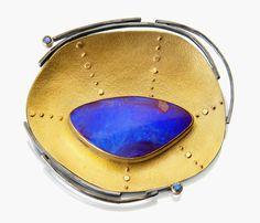 SYDNEY LYNCH Sand Dollar pendant/pin; Boulder opal, aquamarine, blue spinel, oxidized sterling & 22k gold. 2.5 x 2.25 inches.