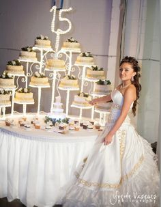 Gorgeous  Quinceañera cake stand and photo idea \\ Photo Credit: Yvette Vazquez Photography #Quinceanerareception # Quinceaneracake