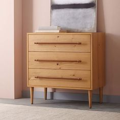 """Benson 3-Drawer Dresser - Natural Oak32""""w x 18""""d x 33""""h. Engineered wood body; Oak veneer in a Natural finish. Leather-wrapped metal drawer pulls finished with hand-stitching. Metal details in an Antique Brass finish."""