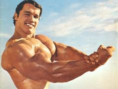Arnold Schwarzenegger posing on the beach in his Mr. Olympia days. One of many celebrities people are surprised to find out has practiced Transcendental Meditation.