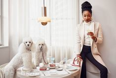 Love this interview! Tiffany Haddish, with toy poodles Jackson and Spencer, at JoJo, a restaurant in New York City. Photograph by Mark Seliger. Guy Aroch, Tiffany Haddish, Catwalk Models, Black Celebrities, Celebs, Restaurant New York, Bargain Shopping, Boyfriend Style, Badass Women