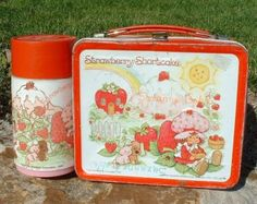 Strawberry Shortcake lunchbox and thermos. Still have it :)