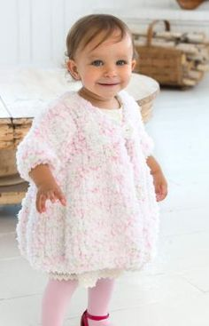 Baby Swing Coat Free Knitting Pattern from Red Heart Yarns