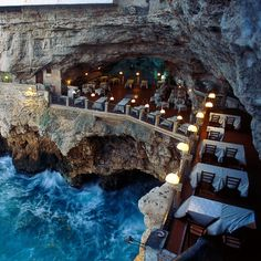 Cut into the side of a mountain, almost like a superhero's hideout,and overlooking the Adriatic Sea, is a restaurant with one of the most striking v...