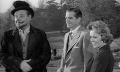 Meeting the Karswells - Night of the Demon - From left to right Mr Karswell (Niall MacGinnis), Professor Holden (Dana Andrews) and Joanna Harrington (Peggy Cummins).