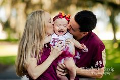 Elizabeth Davis Photography | Baby Session - Mom and Dad kissing little girl's cheeks as she laughs. Click to see the whole session: http://elizabethdavisphotoblog.com/the-g-family-session/