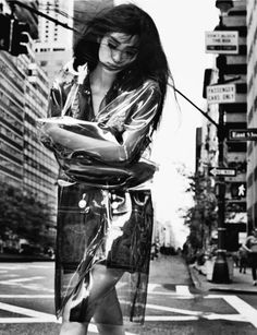 Liu Wen in Numéro China #42 September by Txema Yeste.  In the city with a clear raincoat.