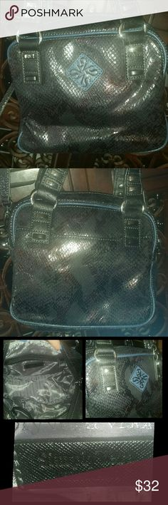 """Simply Vera Vera Wang Snakeskin Crossbody NWOT Brand new without tags, never used  Blue, black and purple snakeskin print small crossbody   This bag is in new condition without any stains, marks or noticeable wear.   Bag has both handles and a removable crossbody strap   Exterior slip pocket on the back of the bag  Interior double slip pocket and zipper pocket with grey - silver lining.  Full zip closure  Measures 9"""" L x 5"""" W x 7.5"""" H with a Removable Drop Strap of 25"""" Simply Vera Vera Wang…"""