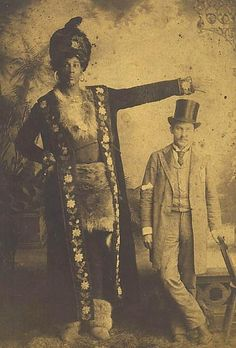 An Unknown Giant of A Man This is an old postcard from my collection of a giant of a man showing off his unusual height in comparison to an average sized man. There is nothing to identify either of them...