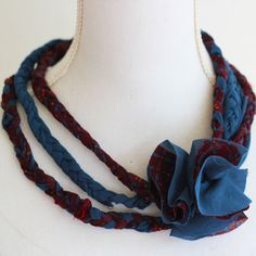 Oh my! A new necklace with braids and a flower for free! Just reuse an old stretchy shirt and start crafting! Perfect for the holidays or as a gift! Tutorial on how to make this necklace:  1. Cut strips of fabric from an old shirt 2. Braid the strips into three different braids…