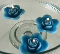 12 Teal floating rose wedding candles for table centerpiece and reception decor.. $14.00, via Etsy.