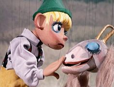 "Puppet show from "" Sound Of Music""   High on a hill was a lonely goat....."