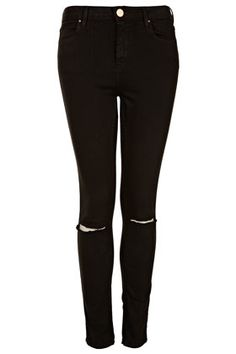 I think I need a new pair I have worn mine out so bad. By: TOPSHOP MOTO Black Rip Knee Jamie Jeans