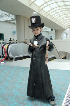Simple steampunk boys costume. I love the hat...a fairly easy DIY with top hat and an old clock.