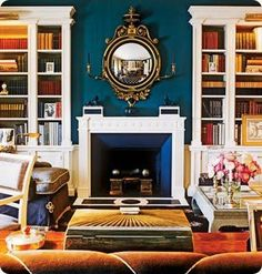 Teal/orange. Love the peacock coloured feature wall. Looks yummy with gold frames and white wood.