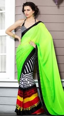 Style and trend will be at the peak of your beauty when you attire this dignified black, lime green, red, white chiffon, cotton, faux georgette & satin saree. This lovely attire is looking extra beautiful with embellishment of block print work. #PrintedSaree #CasualPrintedSaree